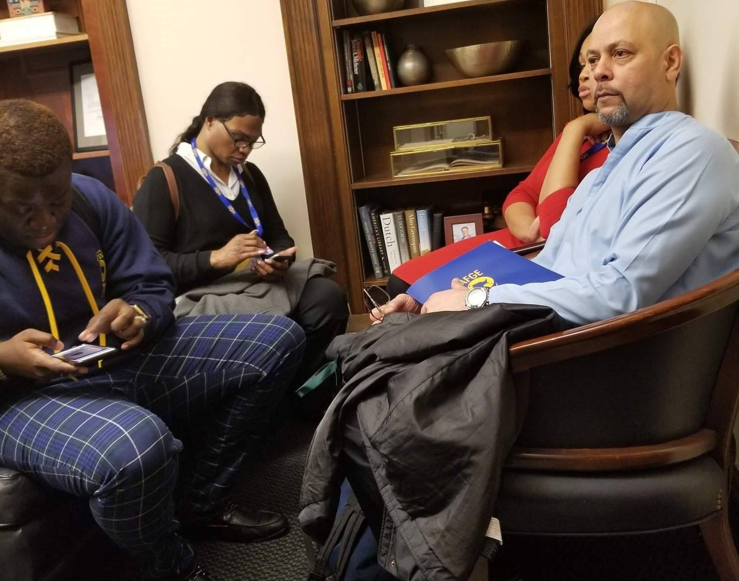 AFGE members in Rep. Ferguson's office Monday seated next to the book display.