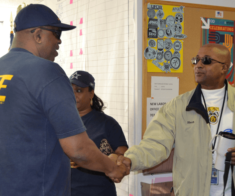 National Secretary-Treasurer Eugene Hudson Jr. greets staff and canvassers